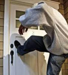 Guy Kicking in Door