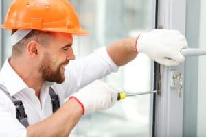 Smiling Locksmith Fixing Door